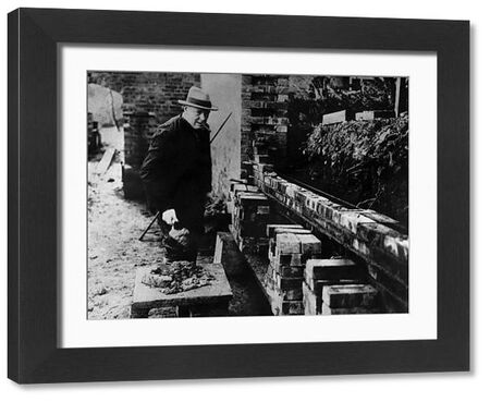 Winston Churchill building a wall at his house Chartwell near Westerham Kent. At one time he held a card in Amalgamated Union of Building Trade Workers  c 1930