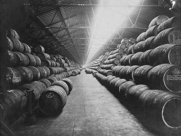 10000 barrels of rum in store at West India Docks, London, England  undated