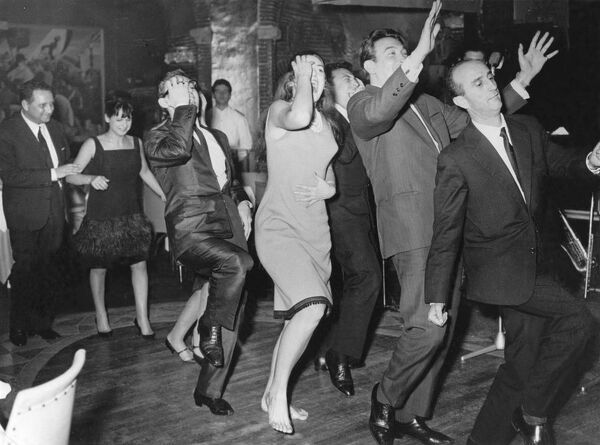 In 1962 The Hully Gully was the new dance craze to sweep across Europe, patrons enjoying themselves at one of Rome's leading clubs  5 December 1962 dance / dancing / party season / celebration / happy vintage news archive