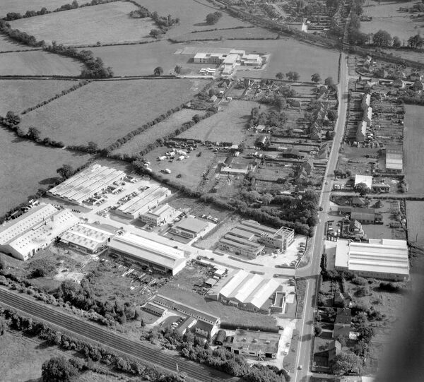 Aerial view of Edenbridge Kent.  industrial estate, bottom left is within the town envelope. agricultural land beyond untouched.  15 September 1962