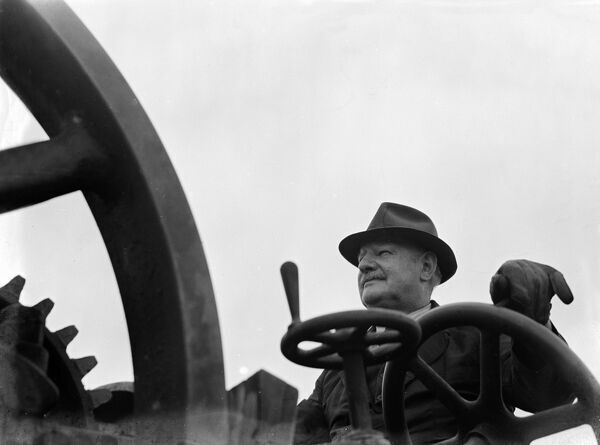 Agricultural Machinery : Mr Chris Lambert, of Horsmonden, Kent, was a steam haulage contractor . A greater part of his work was steam ploughing - where two traction engines hauled a plough on a steel up and down the land .   9 June 1949