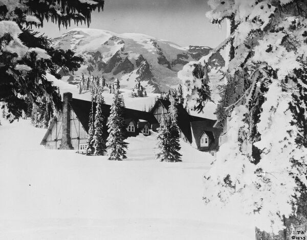America 's record winter.  A photograph from Rainier National Park, Washington, showing Paradise Inn, the popular winter sports centre, almost buried under 22ft snow.  15 February 1927