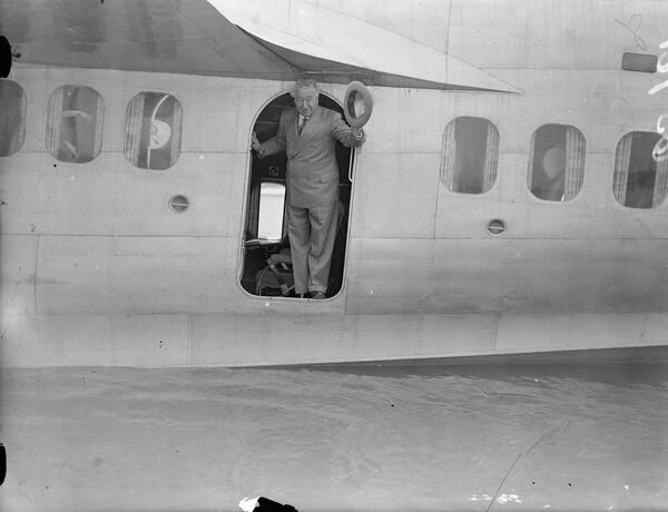 Australian Premier, leaves for Holland by flying boat on way home.  Mr J A Lyon's, the Prime Minister of Australia, boarded the Imperial Airways flying boat 'Challenger'at Rochester for Amsterdam on his way home to Australia after the Coronation