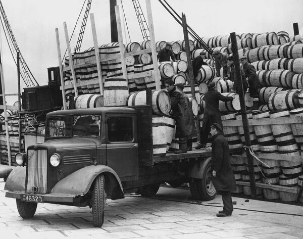 Barrels for the Shetland catch of herring being unloaded at Lerwick, 1949.     Klondyking for fresh herring has begun in the Shetlands.  For two weeks all Shetland Herring Boats (from Lerwick and Scalioway) can land unlimitedcatches of fish