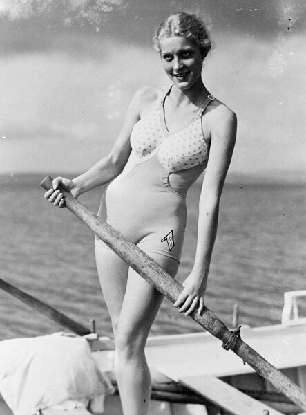 Bathing in brief.  Plenty of air and sun for 1936 beach girl