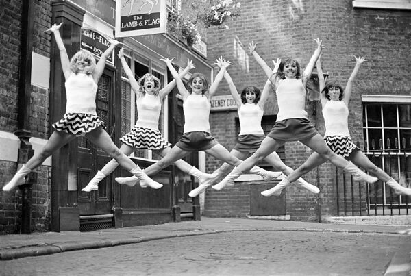 The Beat Girls, from London's Dance Centre near Covent Garden overjoyed by the news that they are flying to Venice to support entries in the Venice Film Festival, photographed outside the Lamb and Flag pub in Covent garden, London  Pictured
