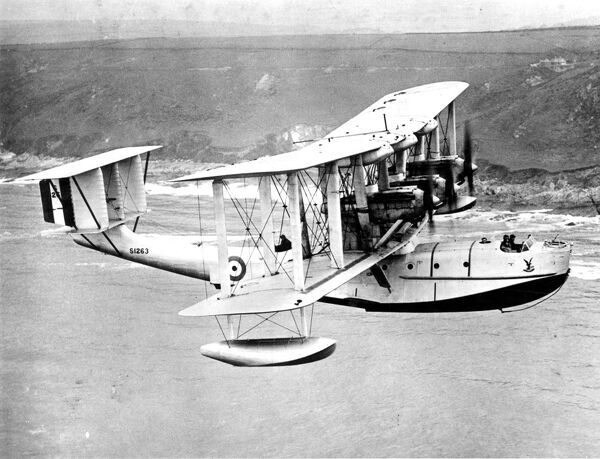 Blackburn Iris Mk III S1263 was a five-seat long-range maritime reconnaissance flying boat built for the Royal Air Force in flight with coastline behind  1929