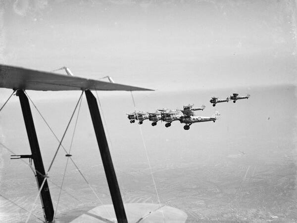 Bristol Bulldogs fighters of No 32 Squadron in formation flying over Biggin Hill.  1936