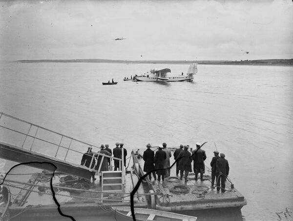 Cheering crowds. The Clipper landing on sea