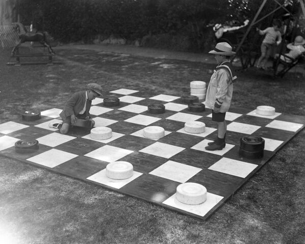 Children play giant draughts in Devonshire Park, Eastbourne, Sussex.  21 June 1920