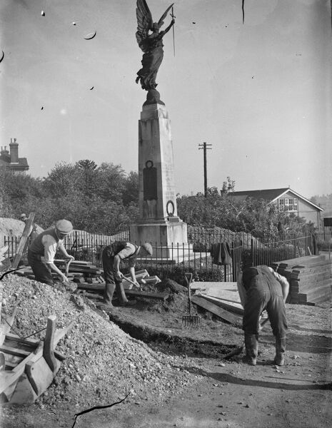 The construction of an Air Raid Precautions shelter beneath a war memorial in Swanley, Kent.  1939