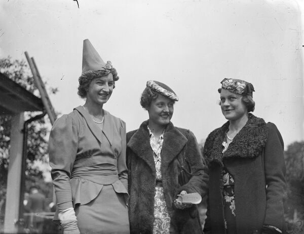 Contrasting hat fashions at free Wimbledon reception.  Three of the original and contrasting hat fashions worn by players attending the special reception given at Roehampton club to competitors in the Wimbledon Championships, opening tomorrow