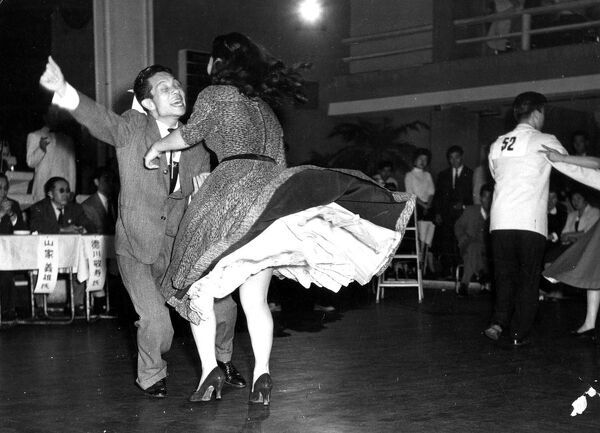 Couple energetically Dancing jive or jitterbug   1950s  dance / dancing / party season / celebration / happy vintage news archive