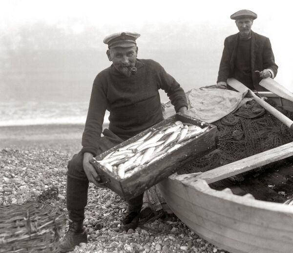 The Coxswain of the Aldeburgh lifeboat , Charlie Mann , with a catch of herrings .     28 September 1925