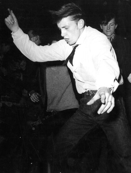 Dancing to rock 'n' roll  1950s dance / dancing / party season / celebration / happy vintage news archive