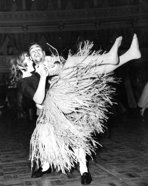 Dancing to rock and roll wearing a grass skirt   dance / dancing / party season / celebration / happy vintage news archive