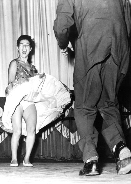 Dancing . The winners of the Hong Kong Rock 'n' roll dancing compeition were these two Portugese contestants Maurice Xavier and his partner Dorothy Mendoza .  1956 dance / dancing / party season / celebration / happy vintage news archive