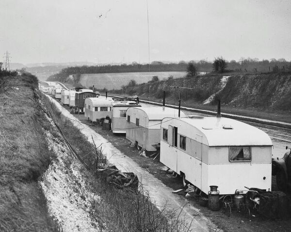 Darenth Gypsies.  Evicted - television and all! Though these gypsies were evicted from Darenth Woods they carried on as usual on the A.2. - many with television sets in operation. Kent, England. 22 January 1962. Travellers Romany Gypsy Gipsy gypsies Roma