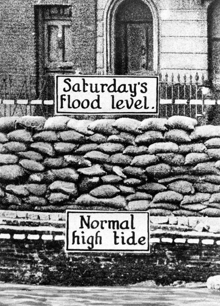 The disastrous overflowing of the Thames: The normal high-tide level at the point at which the embankment broke near Lambeth Bridge, and the level reached by the waters on January 7th.  14 August 1928 History of London - Vauxhall / Lambeth