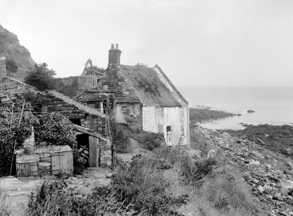 Fisherman 's tumbledown cottage on the north east coast of England .  Early 1900s Fish where the fish are