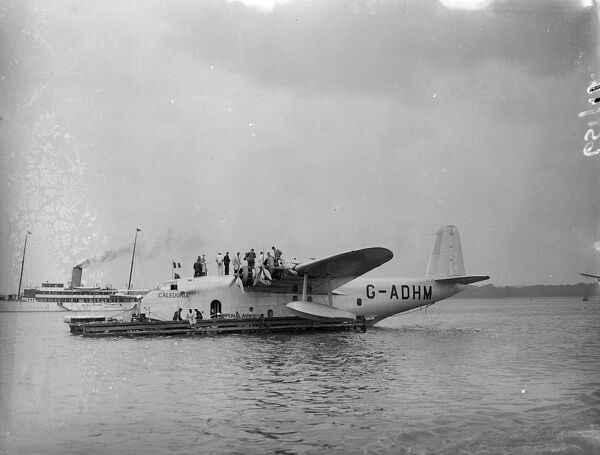 Flying boats 'Caledonia'being prepared for the first commercial Atlantic crossing.  The Imperial Airways flying boat 'Caledonia'is being prepared at Hythe for the first experimental commercial transatlantic crossing which she is to make next week (24 June)