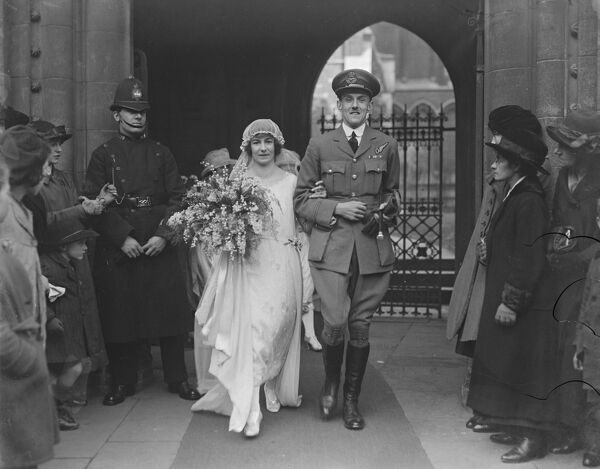 Flying Officer 's wedding in London.  The wedding took place at St Mary 's Church, Kensington, between Mr Herbert Patrick Gardener Legge a pilot officer in the RAF and Miss Valerie Helen Sidgwick of Ipswich.  Bride and Bridegroom leaving the church