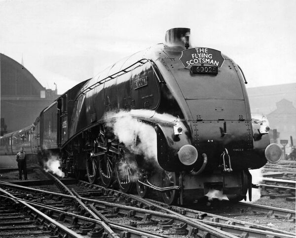 The Flying Scotsman leaving Kings Cross for Edinburgh on the Centenary of the East West Route   7th August 1950