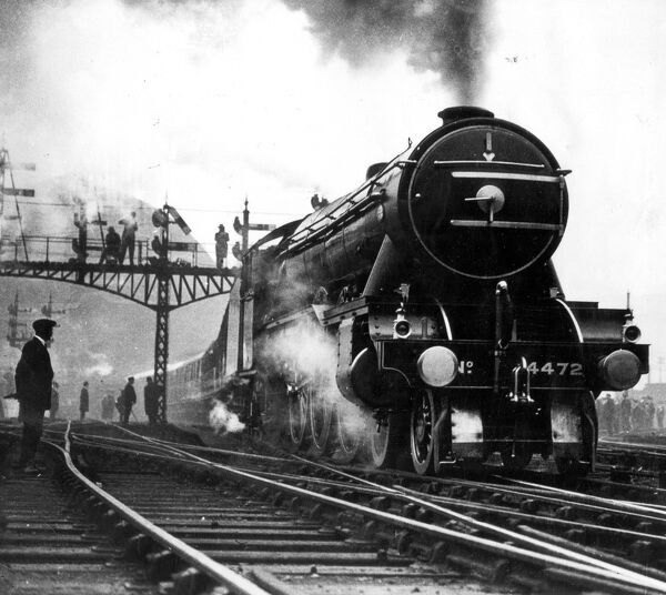 The Flying Scotsman leaving Kings Cross on the first non stop run to Edinburgh May 1st 1928   vintage stills archive picture library stock photographic