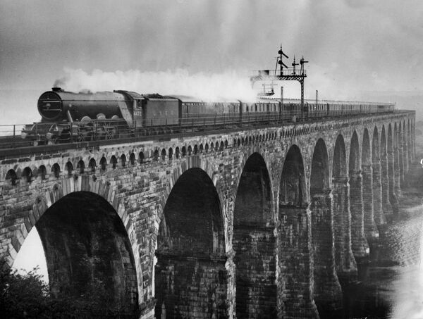 The Flying Scotsman 's 392 miles non stop  The famous Flying Scotsman trains of the LNER made new history when both the Up and Down flyers inaugurated the nonstop runs between Kings Cross and Edinburgh . Photo shows - Over 300 miles nonstop