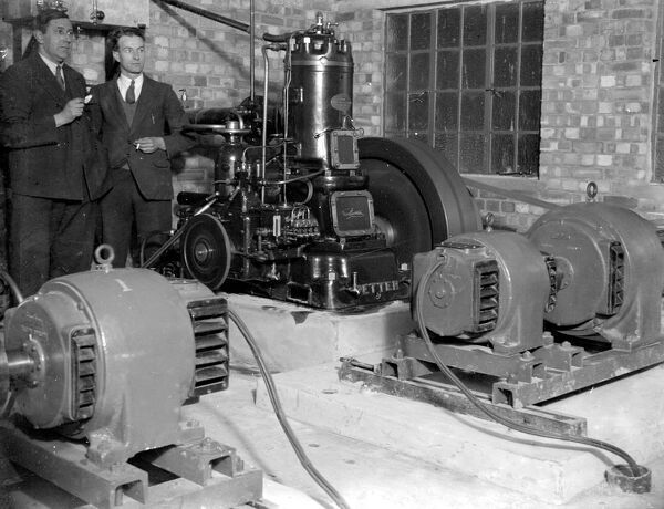 Generators at the Commodore Cinema, Orpington, Kent in the 1930s, with cinema staff looking on.   1933 - movie theatre