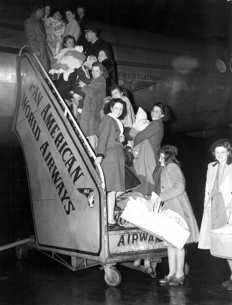 1940s Britain. GI brides catching a plane to New York. London Heathrow 24th December 1946