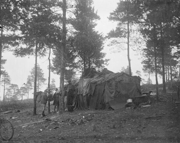 The gypsies are leaving their hundred year old settlement on Hurtwood Hill in Surrey . They lived in huts , caravans and ' benders ( huts with branches bent over and covered with sacks ) - but now they are forsaking their picturesque homes