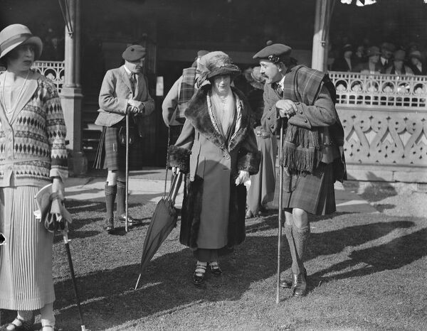 At the Highland Games at Inverness, Scotland ; Lady Marjorie Mackenzie and Mr Seton Gordon  23 September 1923