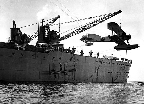 Hoisting out a seaplane from British seaplane carrier HMS Ark Royal , Mudros   January 1916