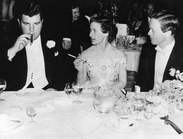 HRH Princess Margaret attending a charity ball in aid of the Dockland Settlement at the Savoy Hotel in London