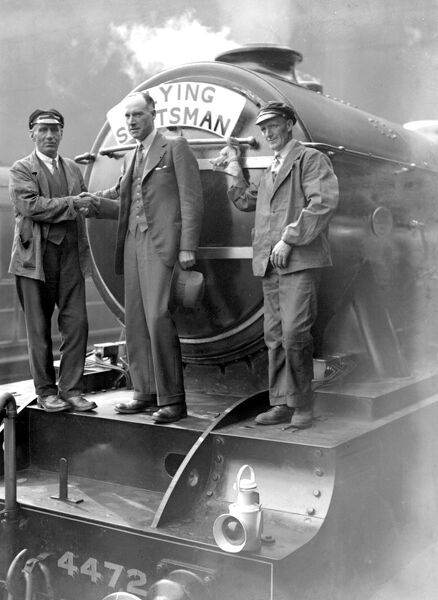 "King's Cross: Captain G. De Haviland, winners of King's Cup Air Race this year sends off the ""Flying Scotsman"" on its first non stop run of the season from London to Edinburgh"