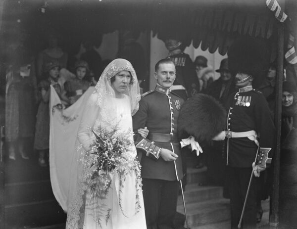 Lady Katharins Carnegie 's wedding.  Mr W B L Manley and Lady K Carnegie were married at the Guards Chapel, Wellington Barracks.  Bride and bridegroom.  22 December 1924