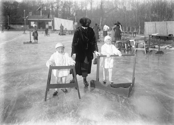 Latest Photographs From Ice Bound Holland  Types of the ingenious ' go kart ' which are used to teach the Dutch children to skate. They not only prevent the little novices falling but save the teacher from being pulled down also  4 December 1921