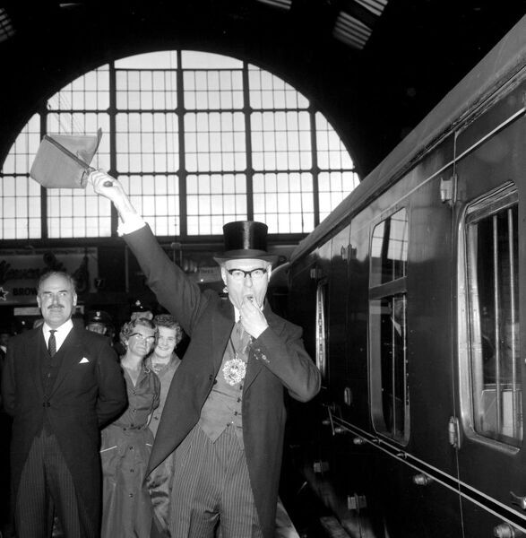 London: Lord Major of London, Sir Frederick Hoare waves flag and blows whistle to give the right away to the Flying Scotsman as it sets of for King's Cross Station.  18 June 1962   vintage stills archive picture library stock photographic