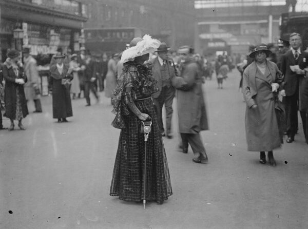 Miss Winifred Gein wears feathers as she left Waterloo Station for Ascot.  20 June 1935