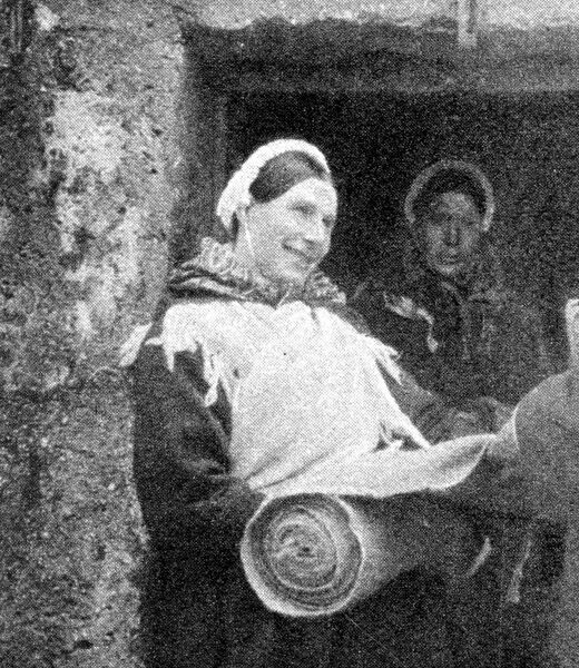 The Evacuation of St Kilda: Island types; And scenes of departure.  A St Kilda woman selling homespun tweed.  6 September 1930 Scotland, Outer Hebrides Scottish history