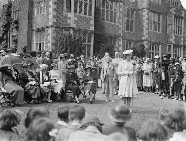 Mr and Mrs Morris Wheeler and Miss F Tomphis at the Horton Kirby fete held at Franks Hall, the Elizabethan country house in Kent.    1939