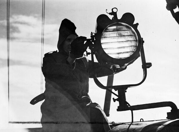 The North Sea Patrol.  Minesweepers of the Royal Navy, free from the hazardous war service, now play a vital role in protecting the rights of the North Sea fishermen