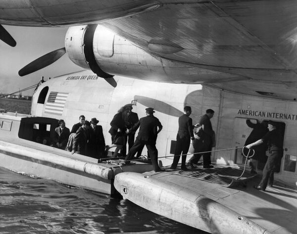 Passengers boarding a flying boat the Bermuda Sky Queen leaving Poole for America on 1 October 1947.   A©TopFoto