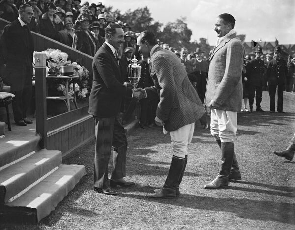 Polo at Hurlingham - Inter Regimental Polo Tournament final, 17/21 Lancers versus Queen 's Bays.  King Alfonso presenting the cup to Mr Laddie Sanford ( Hurricanes ).  30 June 1928