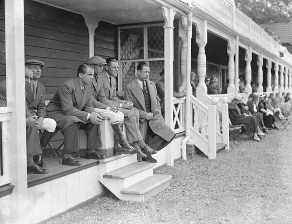 "Polo at the Ranelagh Club, West London. Watching the match between the, "" Knaves "" versus "" Wykham "" in the Buenos Aires Challenge Cup Tournament are, from left to right ; Prince Midivani, Captain Buker, Mr E Tyrrell - Martin"