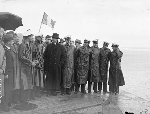 "President Eamon de Valera shaking hands with the commander, Captain Harold E Gray and members of they crew of the ""clipper&quot"