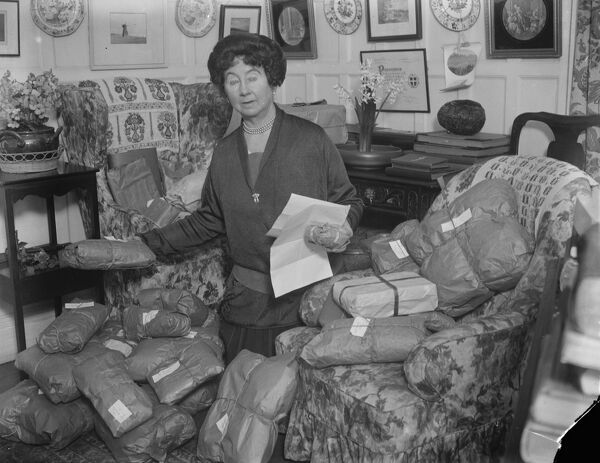 The Prime Minister 's christmas gifts.  Mrs Stanley Baldwin checking the christmas presents which she and her husband are sending out from their residence at Astley Hall, near Stourport.  22 December 1924