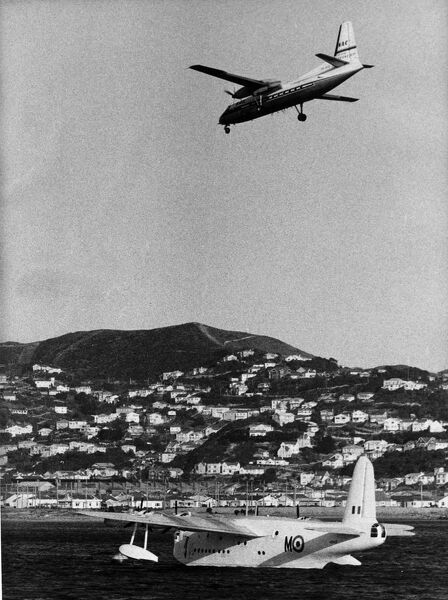 A recent picture taken in Wellington Harbour shows a short Sunderland flying boat of the Royal New Zealand Air Force and a Fokker Friendship belonging to the National Airways Corporation of New Zealand