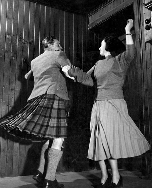 Scottish Country Dancing.   Ian Gillies and partner demonstrate the interlocking swing.  dance / dancing / party season / celebration / happy vintage news archive